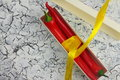 Gift with bitterness on a wooden board in a box are the peppers decorated ribbon Royalty Free Stock Photography