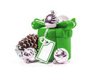 Gift with bow and christmas balls isolate on white background Stock Photography