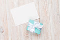 Gift box and blank photo frame or greeting card Royalty Free Stock Photo