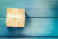 Gift box on blue wooden table Royalty Free Stock Photo