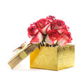 Gift box and bouquet of roses golden isolated on white Stock Photos