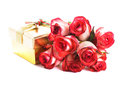 Gift box and bouquet of roses golden isolated on white Royalty Free Stock Images