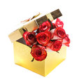 Gift box and bouquet of roses golden isolated on white Stock Photo