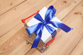 Gift box and caddy on wooden floor Stock Images