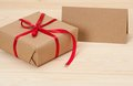 Gift box and card on wooden background Stock Image