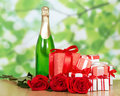Gift in box champagne and red rose close up gifts boxs on green background Royalty Free Stock Photos
