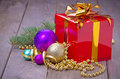 Gift box with christmas balls fir and beads close up Stock Photo