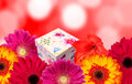Gift box and colorful flowers with blur bokeh background Royalty Free Stock Photo
