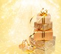Gift box in gold wrapping paper Royalty Free Stock Photo