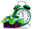 Gift box with green alarm clock Royalty Free Stock Photo
