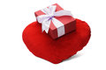 Gift box and heart shaped cushion on on white background Royalty Free Stock Photo