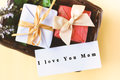 Gift box with I love you mom text on card