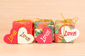 Gift box with love on wooden background Stock Photography