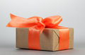 Gift box with orange bow Royalty Free Stock Photo