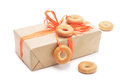 Gift box with orange ribbon and bagel on white background used in the design of a Royalty Free Stock Photography