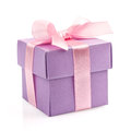 Gift box with pink ribbon and bow Stock Photos