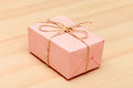 Gift box pink on wood background Royalty Free Stock Image