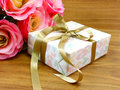 Gift box present with ribbon decorations Royalty Free Stock Photo