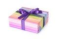 Gift box with purple ribbon Stock Photos