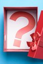 Gift Box With A Question Mark Symbol Royalty Free Stock Photo