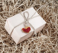 Gift box with red beaded heart on sawdust vintage style Stock Photo