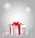 Gift box with red bow on abstract background Royalty Free Stock Photo