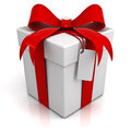 Gift box with red ribbon bow and blank tag on white background Royalty Free Stock Photo