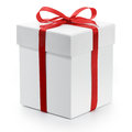 Gift box with red ribbon bow isolated on white background Stock Images