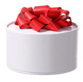 Gift box with red ribbon bow round Royalty Free Stock Image