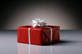 Gift box red with white bright bow on grey and dark background Royalty Free Stock Photography