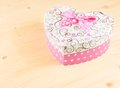 Gift box with ribbon on wood table, concept of valentine day Royalty Free Stock Photo