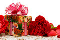 Gift box with rose on a silk Royalty Free Stock Photo