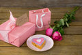 Gift box with roses and heart shape cookies Royalty Free Stock Photo