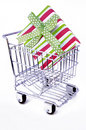 Gift box in shopping cart Royalty Free Stock Photography