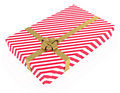 Gift box, striped, with ribbons, isolated on white Royalty Free Stock Photo