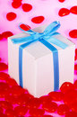 Gift Box Surrounded by Candy Hearts Stock Photos