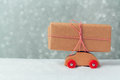 Gift box on toy car. Christmas holiday celebration concept Royalty Free Stock Photo