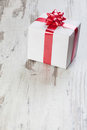Gift box on a white board Royalty Free Stock Photography