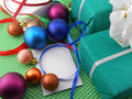 Gift box with a white ribbon and new year balls Stock Images
