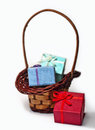 Gift boxes and wicker basket Royalty Free Stock Photo
