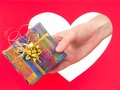 Gift box woman hand give a against red heart concept Royalty Free Stock Photos