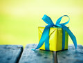 Gift box on wooden table Royalty Free Stock Photo