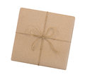 Gift box wrapped in brown recycled paper and tied sack rope top Royalty Free Stock Photo