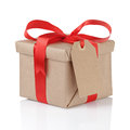Gift box wrapped with kraft paper and red bow Royalty Free Stock Photo