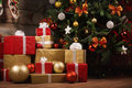Gift boxes and balls under christmas tree Royalty Free Stock Photo