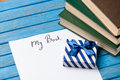 Gift boxes books and paper with my book words on blue background Stock Images