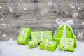 Gift boxes with bow and snowflakes on wooden background Stock Images