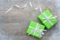 Gift boxes with bow and snowflakes on wooden background Stock Image