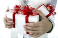 Gift boxes in the children`s hands Royalty Free Stock Photo