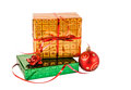 Gift boxes and christmas ball isolated on white Royalty Free Stock Photo